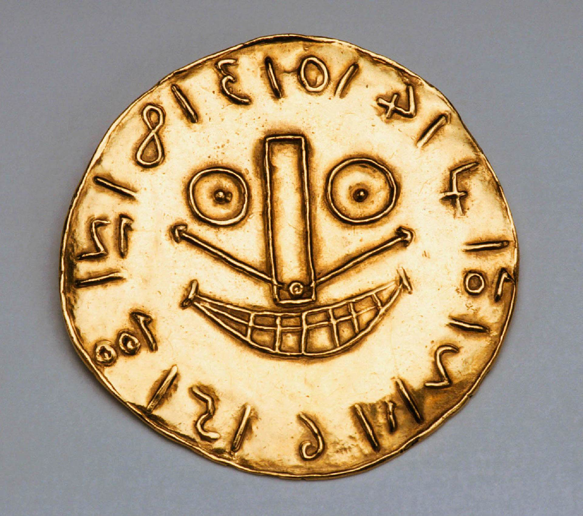 Face in the Form of a Clock Pendant