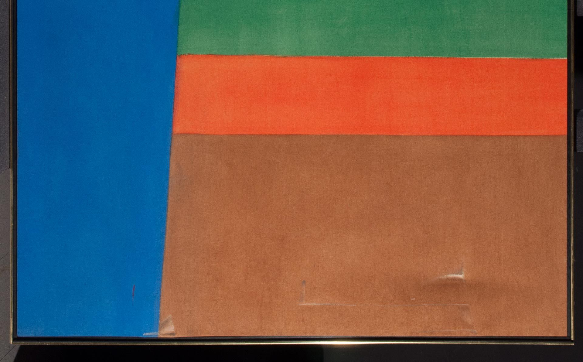 The impact from an accident caused a large indentation in the canvas in the lower section of the composition.