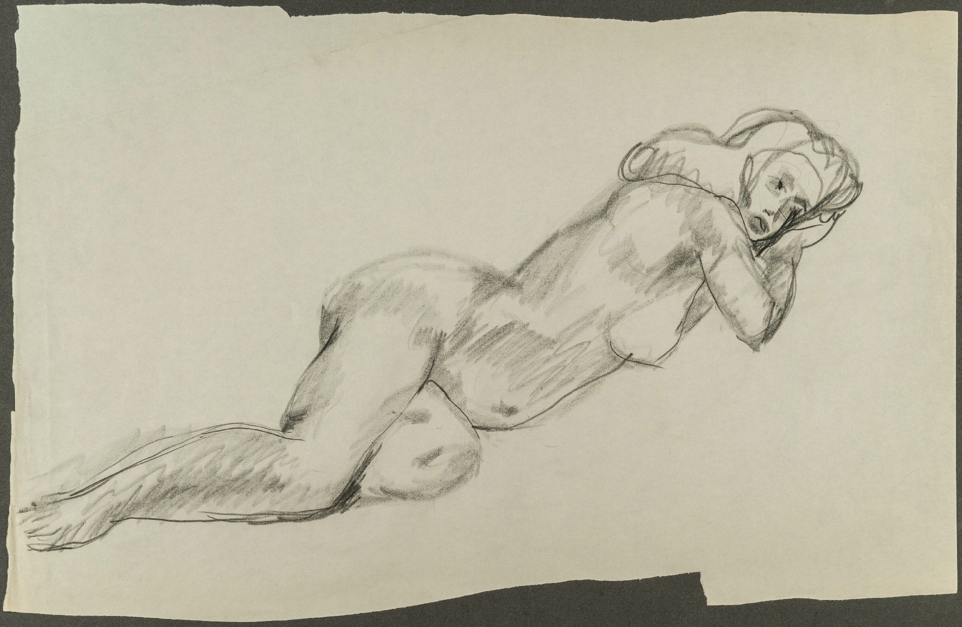Nude Black Woman Lying on Her Side With Her Hands Under Her Head