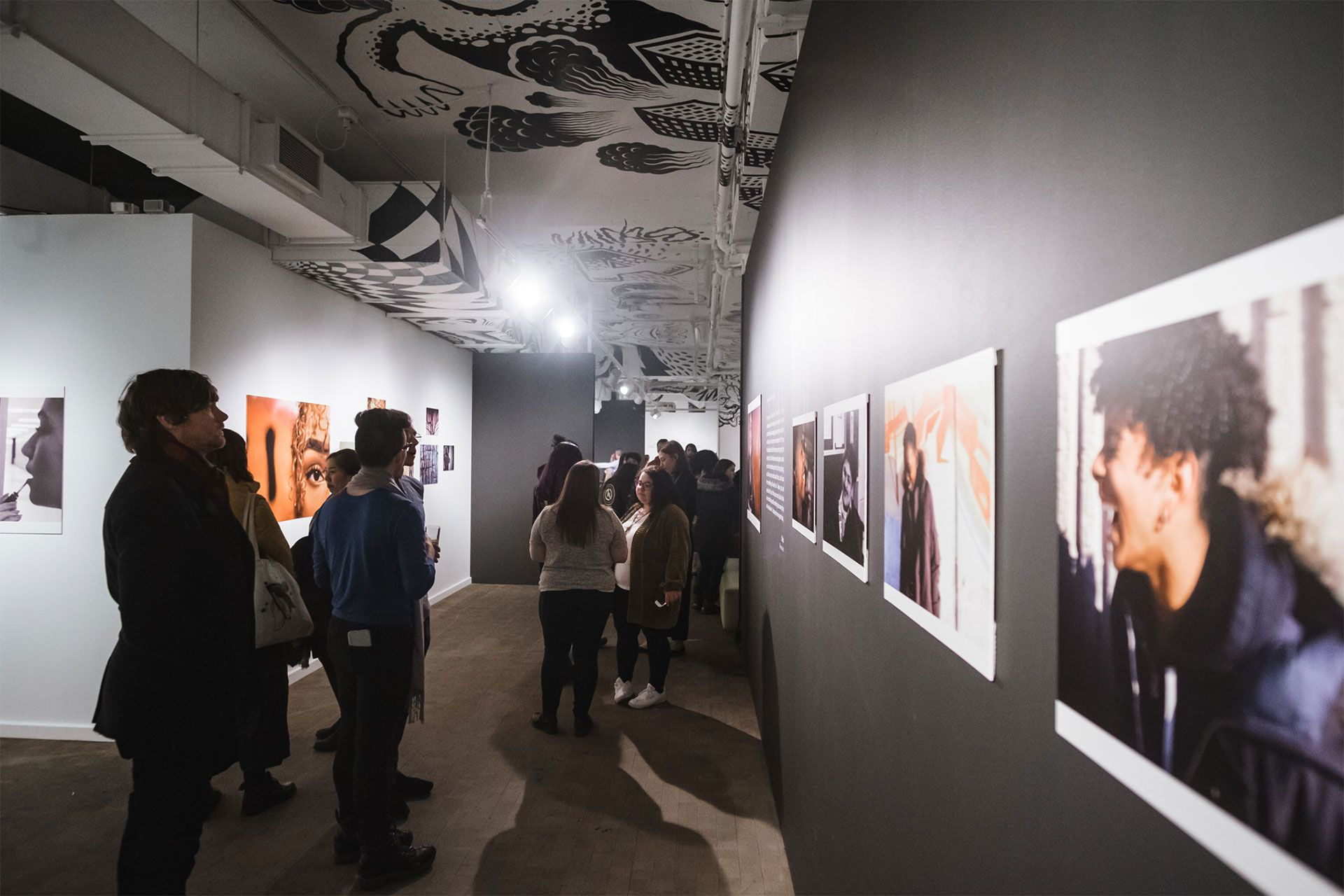 A group of adults visits a photo exhibition at the Museum. Photo Olivier Savoie