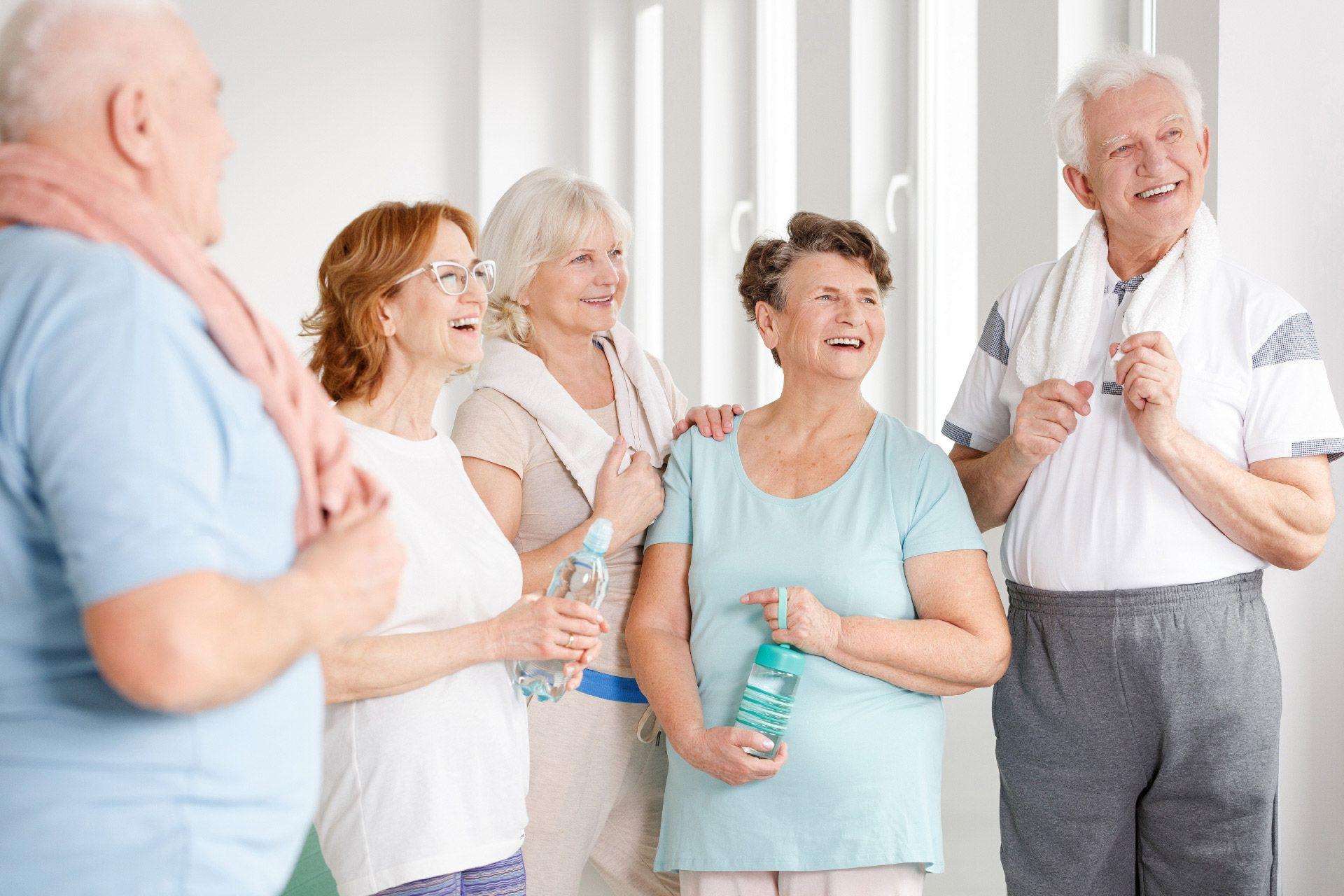 seniors attending a yoga class