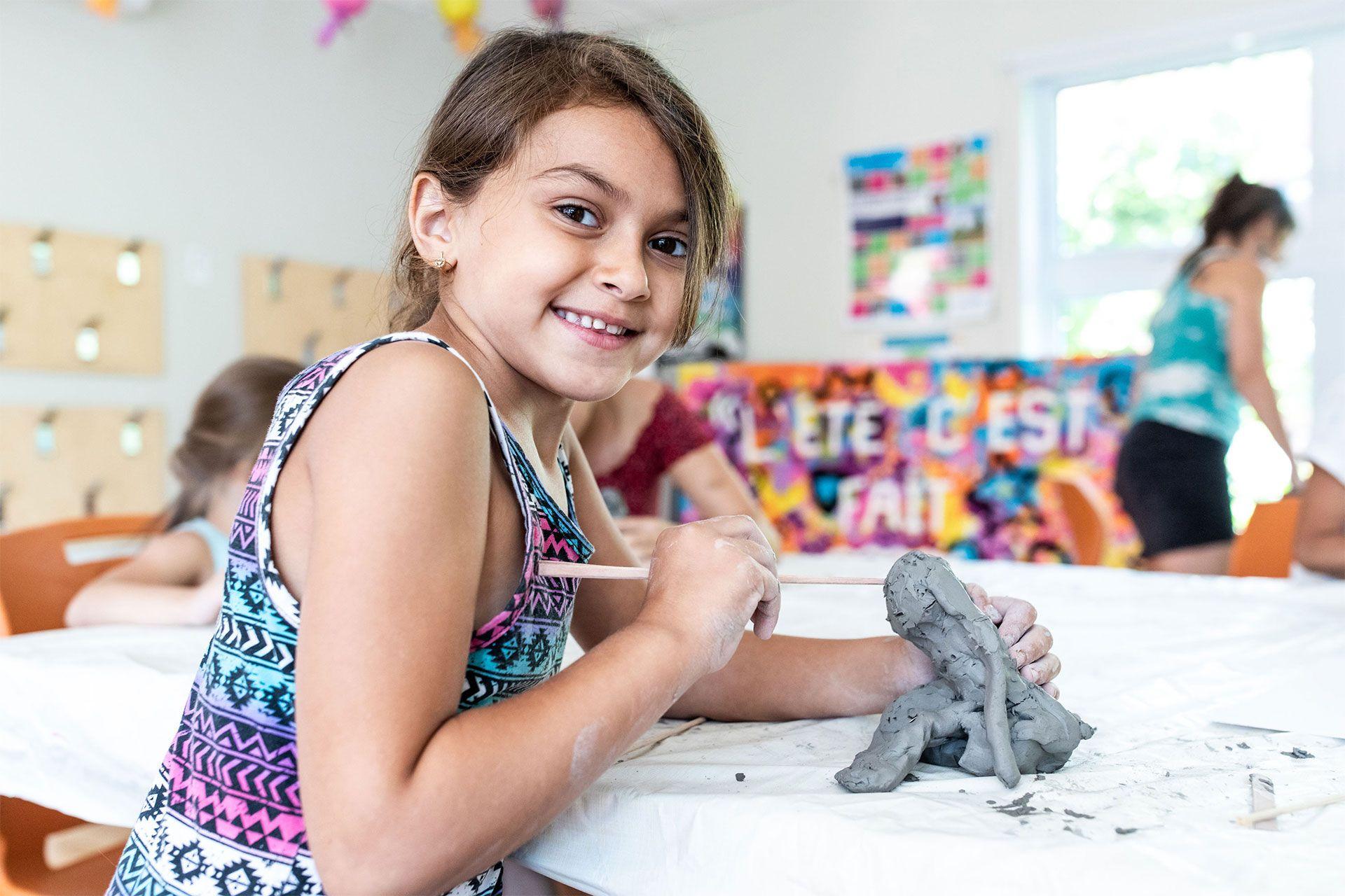A child makes sculpture.
