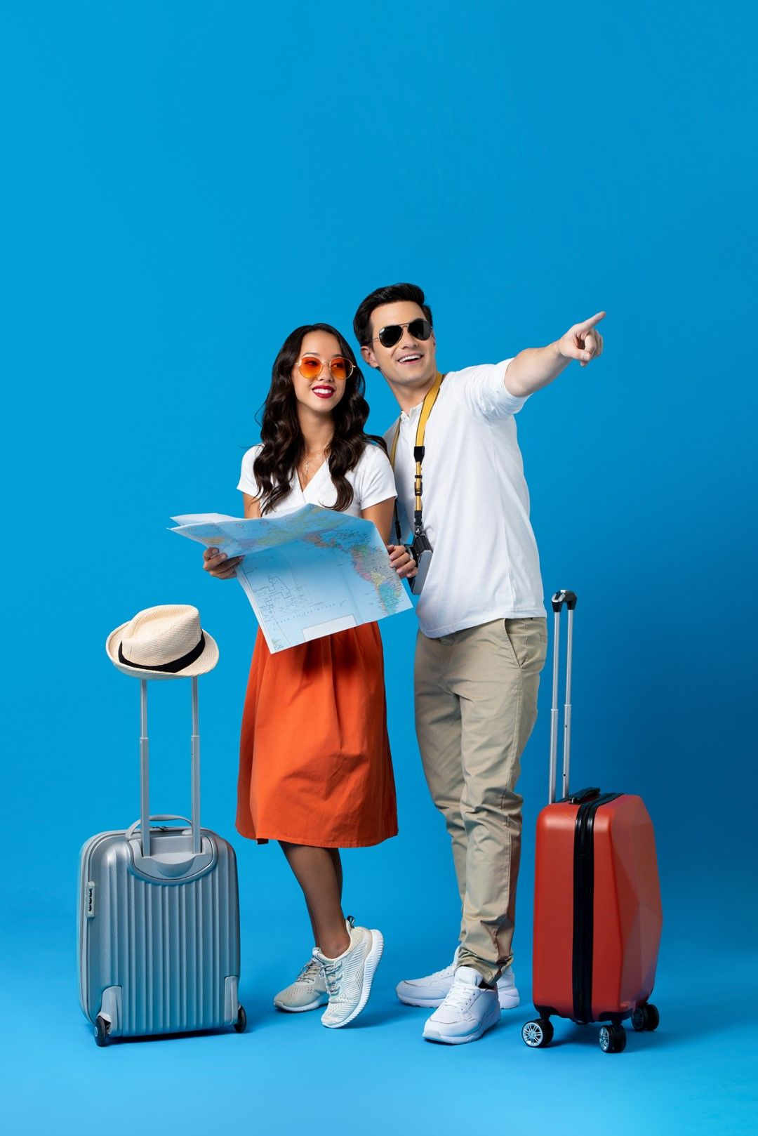 Two members with their suitcases