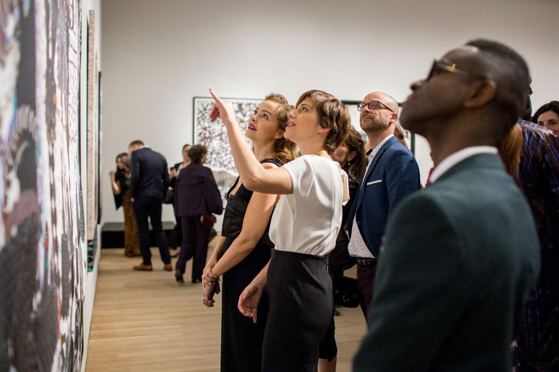 Members of MMFA's Angel Circle durine Omar Ba's exhibition