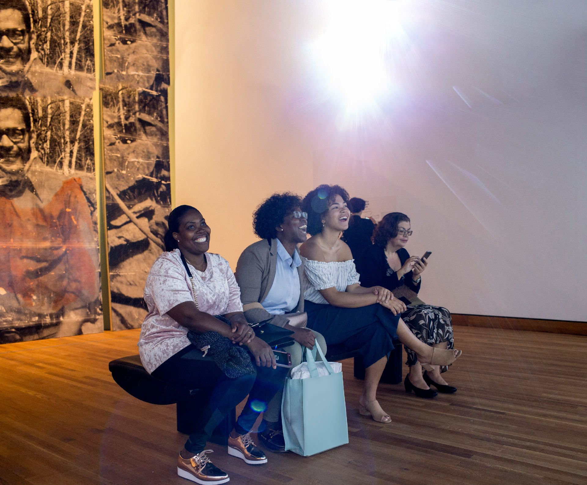 Group of women at an exhibition opening. Photo © Sébastien Roy