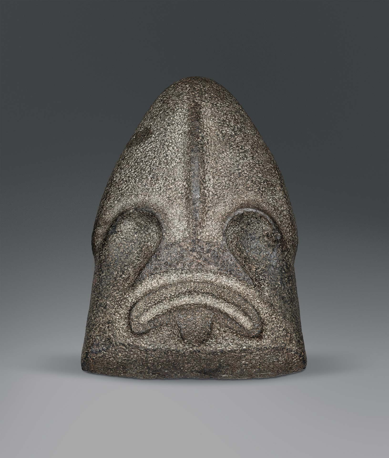 British Columbia, Northwest Coast, Bella Coola, Kwakwaka'wakw, Piledriver head, about 400–1800, stone, 40 x 24.1 x 8.3 cm. Philadelphia Museum of Art, the Louise and Walter Arensberg Collection, 1950. Photo Philadelphia Museum of Art: The Louise and Walter Arensberg Collection, 1950