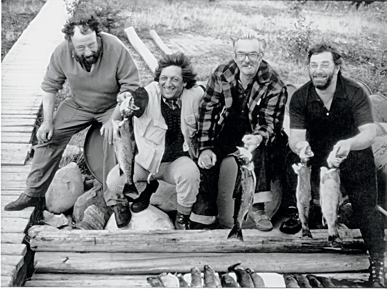 Claude Duthuit photograph of Paul Rebeyrolle, Riopelle, Jacques Lamy and Champlain Charest on a fishing trip, about 1975, print 2020, black and white photograph. Archives Yseult Riopelle. © Estate of Jean Paul Riopelle / SOCAN (2020). Photo Claude Duthuit – Archives Yseult Riopelle